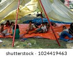 Small photo of Banda Aceh, Aceh, Indonesia - December 30, 2004: Kids playing at shelter camps in Mata ie banda aceh, their villages and homes destroyed when Earthquake and Tsunami disaster in December 26 2004