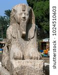 Small photo of MIT RAHINA, EGYPT - MAY 03, 2013 : The alabaster sphinx of Amun-Ofis 2nd at the ancient Egyptian capital of Memphis in northern Egypt. The statue is four and a half metres high and eight metres long.