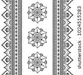 henna tattoo flower template... | Shutterstock .eps vector #1024515283
