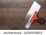 new putty knife with red handle ... | Shutterstock . vector #1024519813