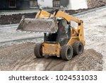 yellow wheel skid steer loader... | Shutterstock . vector #1024531033
