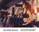asian woman drinking protein... | Shutterstock . vector #1024556587