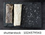 salted dried cod on black stone ...   Shutterstock . vector #1024579543