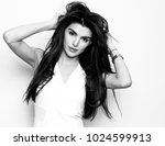 beautiful young woman with long ... | Shutterstock . vector #1024599913