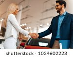 young woman shaking hands after ... | Shutterstock . vector #1024602223