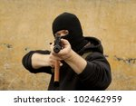 Warrior in mask with gun - stock photo