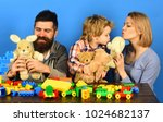 parents and kid cuddle with... | Shutterstock . vector #1024682137