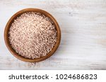 raw pink rice in a bowl on a... | Shutterstock . vector #1024686823