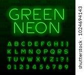 green neon lamp alphabet font.... | Shutterstock .eps vector #1024694143