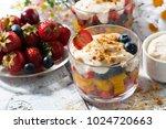 fresh fruit dessert with... | Shutterstock . vector #1024720663