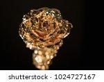 golden rose on black background.... | Shutterstock . vector #1024727167