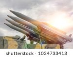 four rockets are directed...   Shutterstock . vector #1024733413
