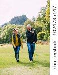 senior couple are enjoying a... | Shutterstock . vector #1024735147
