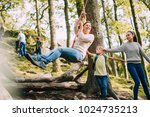 mature woman is being pushed on ... | Shutterstock . vector #1024735213
