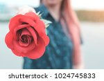young woman holding a red rose... | Shutterstock . vector #1024745833