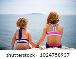 Two Girls In Bathing Suits...