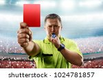 referee showing the red card in ... | Shutterstock . vector #1024781857