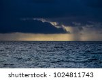 stormy sky over the sea in... | Shutterstock . vector #1024811743