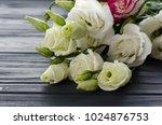 eustoma flowers on grey... | Shutterstock . vector #1024876753