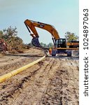 Small photo of DOBA, CHAD - CIRCA 2013: Installation of an underground oil pipeline