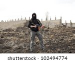 Warrior with gun in the battlefield - stock photo
