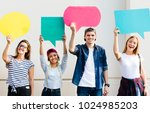 young adult friends holding up... | Shutterstock . vector #1024985203