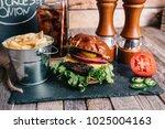 cheeseburger on a pretzel bun... | Shutterstock . vector #1025004163