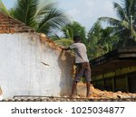 old brick wall demolishing by...   Shutterstock . vector #1025034877