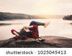 relaxing moment asian tourist... | Shutterstock . vector #1025045413