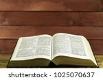 bible on a gold table.... | Shutterstock . vector #1025070637