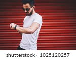 young hipster guy checking time ... | Shutterstock . vector #1025120257