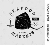 seafood market logo with ray.... | Shutterstock .eps vector #1025129203