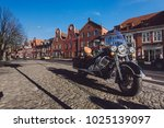 Small photo of April, 9th - Potsdam, Brandenburg, Germany. Classic motorbike on Dutch district with holland brick merchant houses on paved street by sunny day. Popular tourist place in Potsdam.