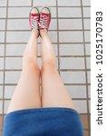 selfie of sneakers. woman... | Shutterstock . vector #1025170783
