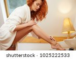 young redhaired woman in the...   Shutterstock . vector #1025222533