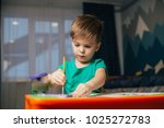 young boy painting decorative... | Shutterstock . vector #1025272783