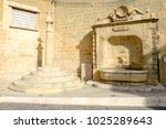 old fountain in center of... | Shutterstock . vector #1025289643