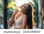 the charming girl stands on the ... | Shutterstock . vector #1025298547