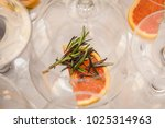 a glass with a grapefruit slice ... | Shutterstock . vector #1025314963