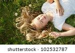 Girls Sleeping In A Field Of...
