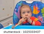 7 month children  eating a bone ... | Shutterstock . vector #1025333437