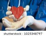 doctor pushing button heart... | Shutterstock . vector #1025348797