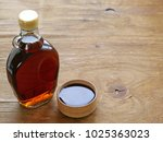 maple syrup in a glass bottle   ... | Shutterstock . vector #1025363023