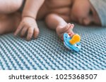 baby with a nipple. close up of ... | Shutterstock . vector #1025368507