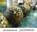 round stones buried in the... | Shutterstock . vector #1025398933