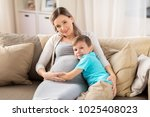 pregnancy  people and family... | Shutterstock . vector #1025408023