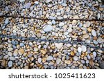 Rusty Chain Laid On Pebbles ...