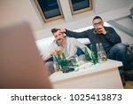 friends watching sport on tv at ... | Shutterstock . vector #1025413873