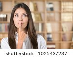 woman thinking in library | Shutterstock . vector #1025437237