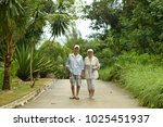 elderly couple rest at tropical ... | Shutterstock . vector #1025451937